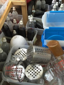 Dye bottles and measuring supplies wait for their turn to be cleaned up.